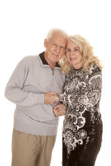 elderly couple heads together smile