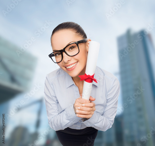 smiling businesswoman in eyeglasses with diploma