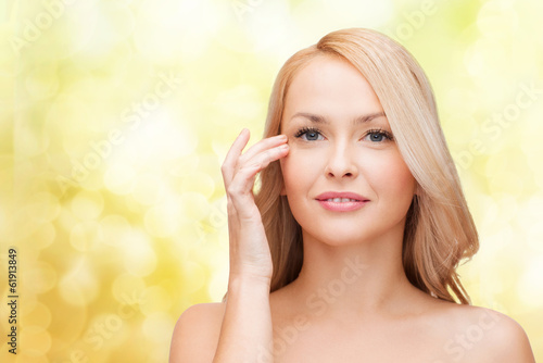 beautiful woman touching her eye area