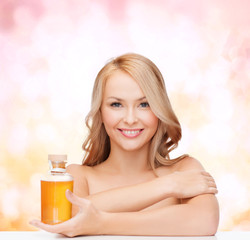 happy woman with oil bottle