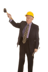 elderly man suit hardhat lift tool