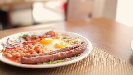 Plate with tasty english breakfast