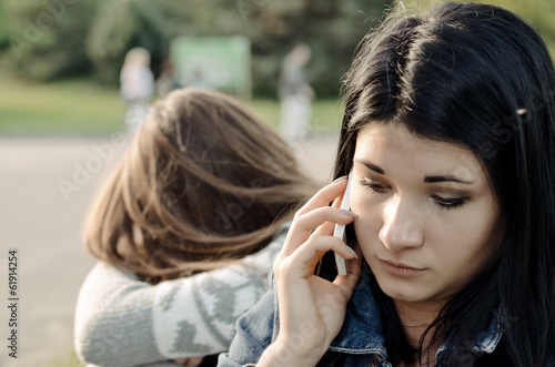 Beautiful young woman chatting on her mobile phone