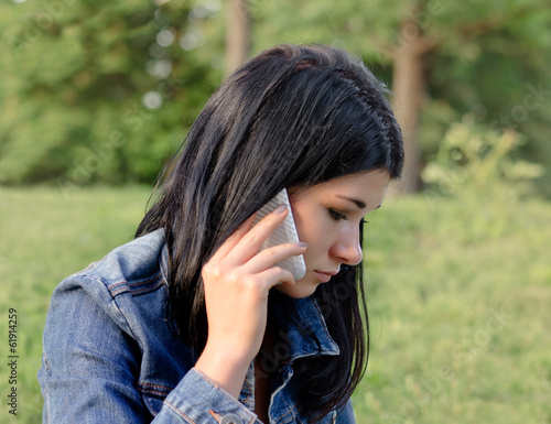 Young girl listening to a call on her mobile