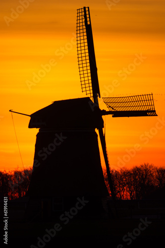 backlit Dutch windmill during sunrise
