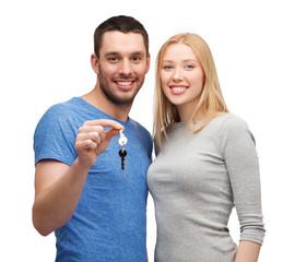 smiling couple holding keys