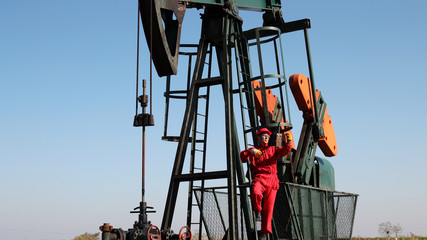 Pumpjack and Oilfield Worker.