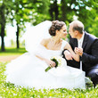 Wedding couple. Happy bride and groom in a summer park