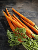 Fresh Organic Carrots on dark wooden background
