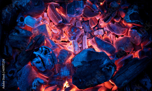 Burning campfire embers (hot coal)