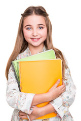 Little student holding notebook