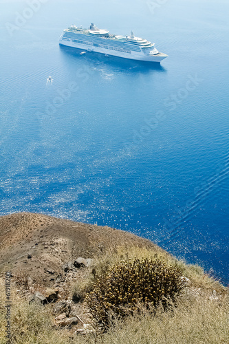 View of the blue sea and the white ship with the high coast of t