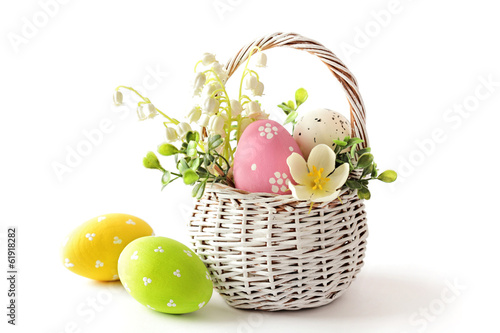 canvas print picture easter eggs in basket isolated on white background