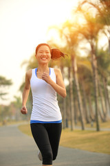 healthy lfiestyle woman running at tropical park