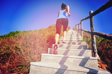woman running up at mountain stone stair