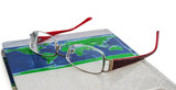glasses lie on the book