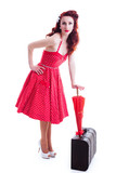 Beautiful pin-up girl with suitcase and umbrella