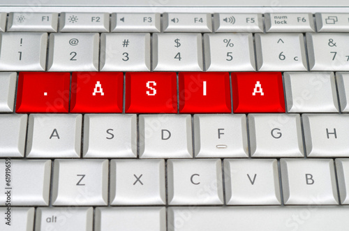 Intenet top level domain .asia spelled on metallic keyboard