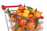 Ripe tasty tangerines in shopping cart isolated on white