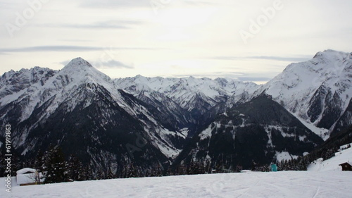 Group of skiers and snowy hill slope, Alps, Austria