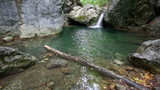 Waterfall and lake with clear water in wild nature, lounge video