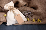 Textile sachet pouch with dried flowers, herbs