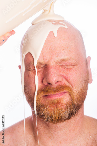 Messy of milk on man