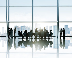 Silhouettes of Business People Meeting in the Office