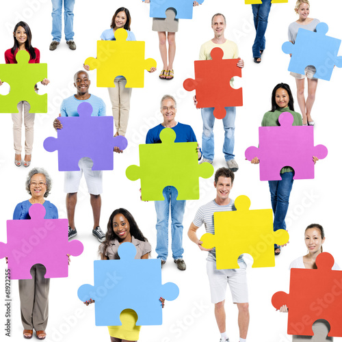 Diverse World People Holding Jigsaw Pieces
