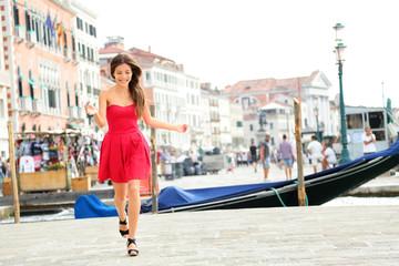 Happy summer girl running in dress, Venice, Italy
