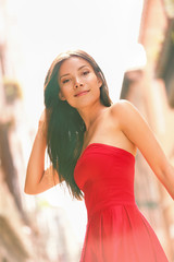 Fashion woman portrait in red dress outside