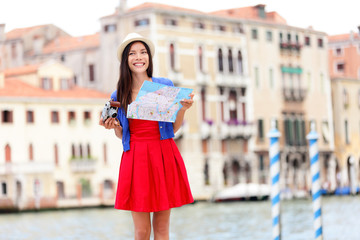 Woman travel tourist with camera in Venice, Italy