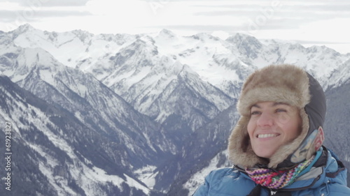 Young woman breathing fresh air in winter mountains, Alps