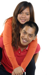 Playful young couple standing hugging