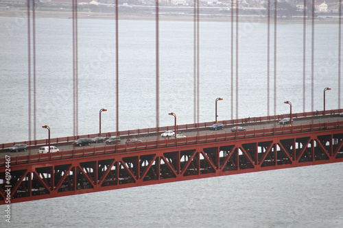 close up of Golden Gate Bridge and traffic on it - 61924467