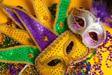 Fototapety Colorful group of Mardi Gras or venetian mask on yellow
