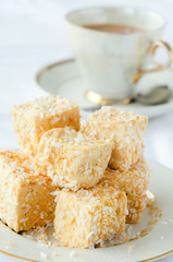 Golden marshmallow cubes with coconut bits