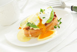 Breakfast. Poached egg with hollandaise sauce,