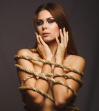 brunette girl woman bound with rope prisoner