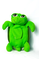 Green turtle toy on a white background