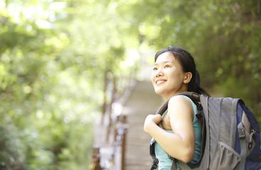 woman hiker climbing stone stairs at huashan mountain