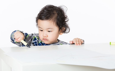 Little boy concentrate on drawing