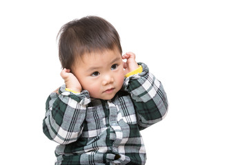 Asian baby boy touch his ear