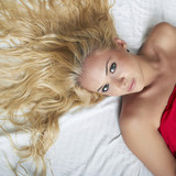 Beautiful blond woman on the bed