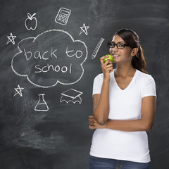 Indian teacher and chalkboard with Back to School concept hand d