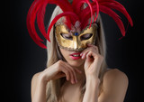 Glamour photo of sexy woman wearing mysterious venetian mask