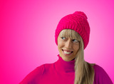 Woman with pink winter hat on pink background
