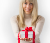 Woman giving present in white box