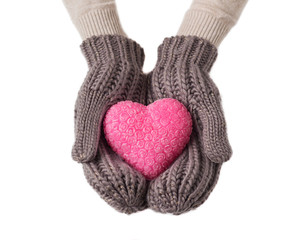 Pink heart in warm wool gloves