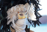 A black and white feathers mask at Carnival of Venice